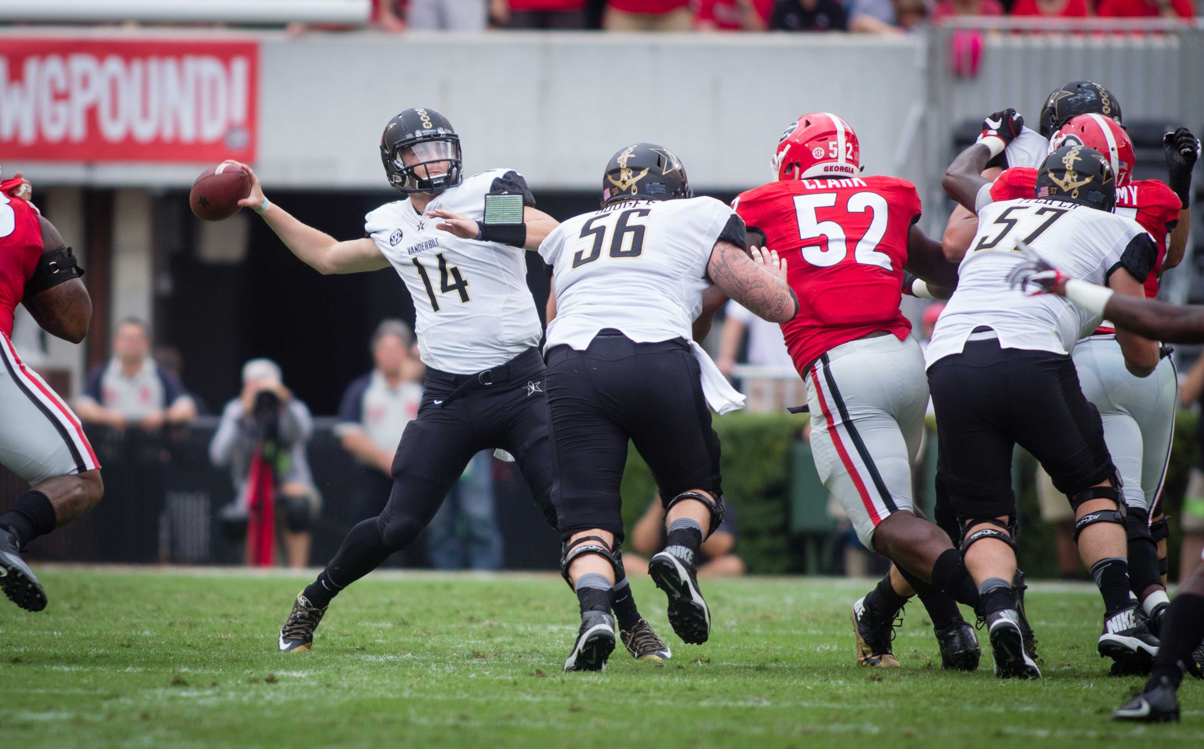 October 15th, 2016 – Kyle Shurmer passes during the Commodores' 17-16 win against the University of Georgia in Sanford Stadium Saturday afternoon. Credit: Blake Dover