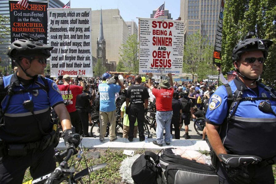 Cleveland, Ohio, USA - July 19, 2016: Bicycle police protect the rear of a Westboro Baptist Church demonstration in the Public Square on the second day of the Republican National Convention. The WBC is primarily known for its hate speech directed at the LGBTQ community, Muslims, Jews, Catholics and soldiers killed in combat defending the concept of liberal democracy (Getty Images)