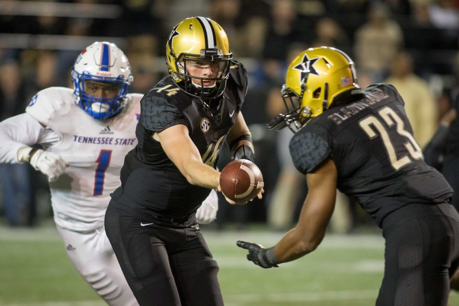 October 22nd, 2016 – Kyle Shurmur (14) hands the ball off during the Commodores' 35-17 win against TSU Saturday night at Vanderbilt Stadium. Photo by Blake Dover.