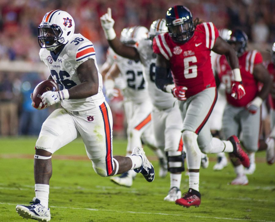 Kamryn 'Bubba' Pettway (36) runs for an Auburn touchdown in the first half. Auburn vs Ole Miss on Saturday, Oct. 29 in Oxford, MS. Photo credit: Adam Sparks