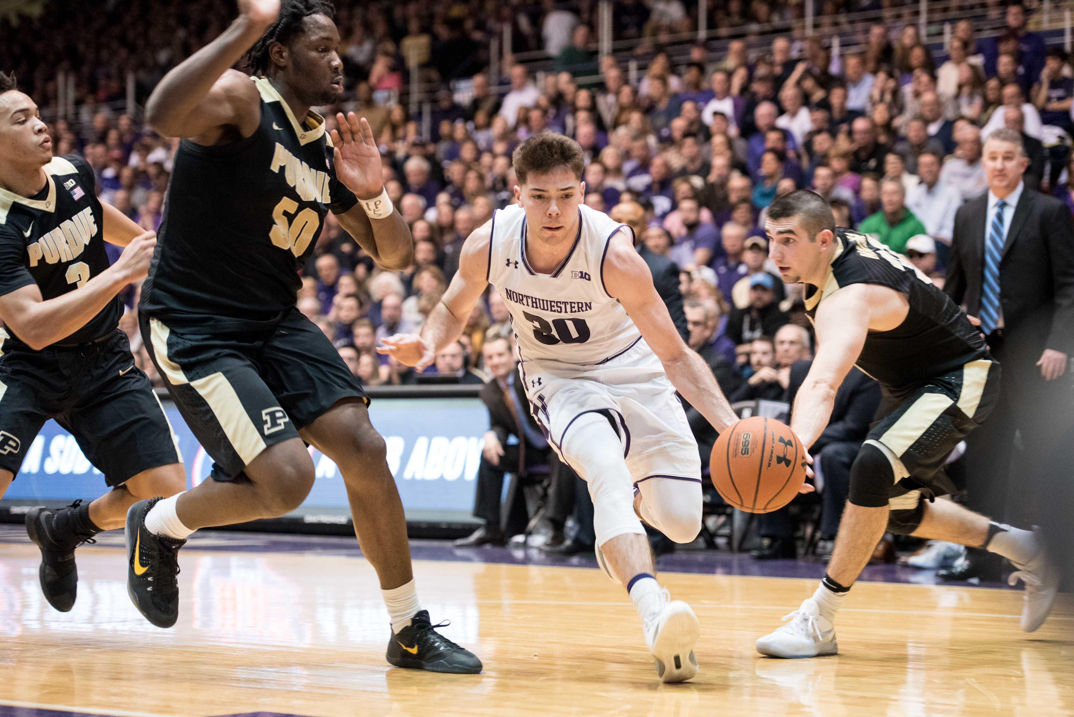 Northwestern's Bryant McIntosh drives to the basket against Purdue on March 5, 2017. (Colin Boyle/Daily Northwestern)