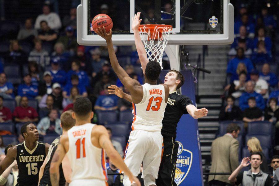 Vanderbilt+center+Luke+Kornet+defends+the+basket+against+Florida+in+the+SEC+tournament+March+10%2C+2017+at+Bridgestone+Arena.
