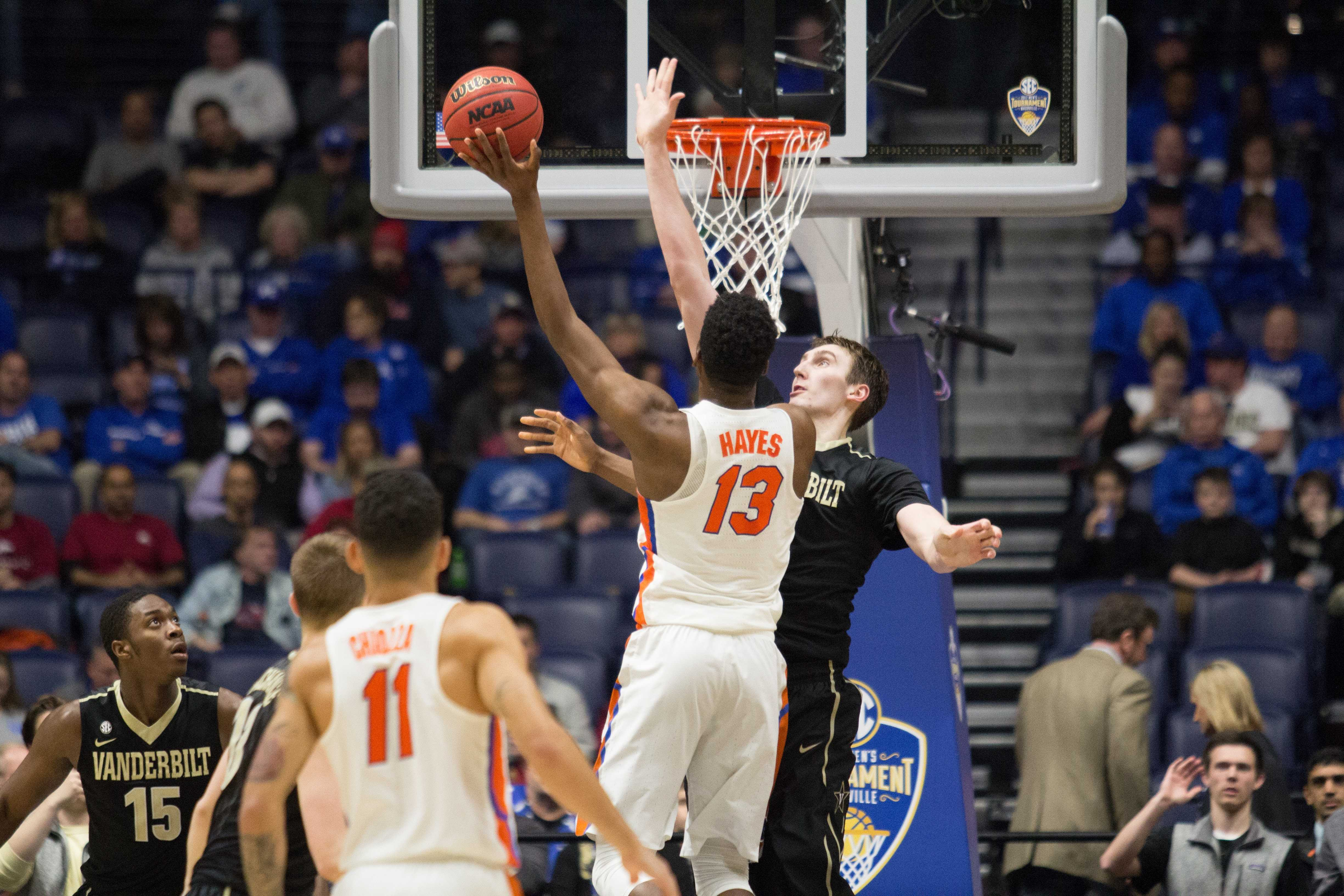 Vanderbilt center Luke Kornet defends the basket against Florida in the SEC tournament March 10, 2017 at Bridgestone Arena.