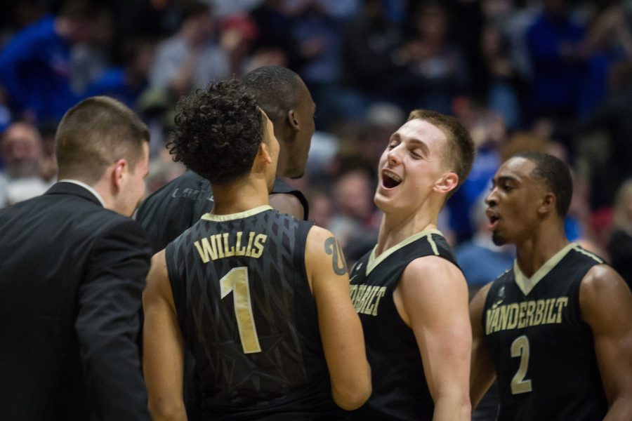 Payton Willis and Riley LaChance (middle) celebrate as Vanderbilt defeated No. 17 Florida 72-62 in overtime in the SEC tournament quarterfinals Friday, March 10, 2017.