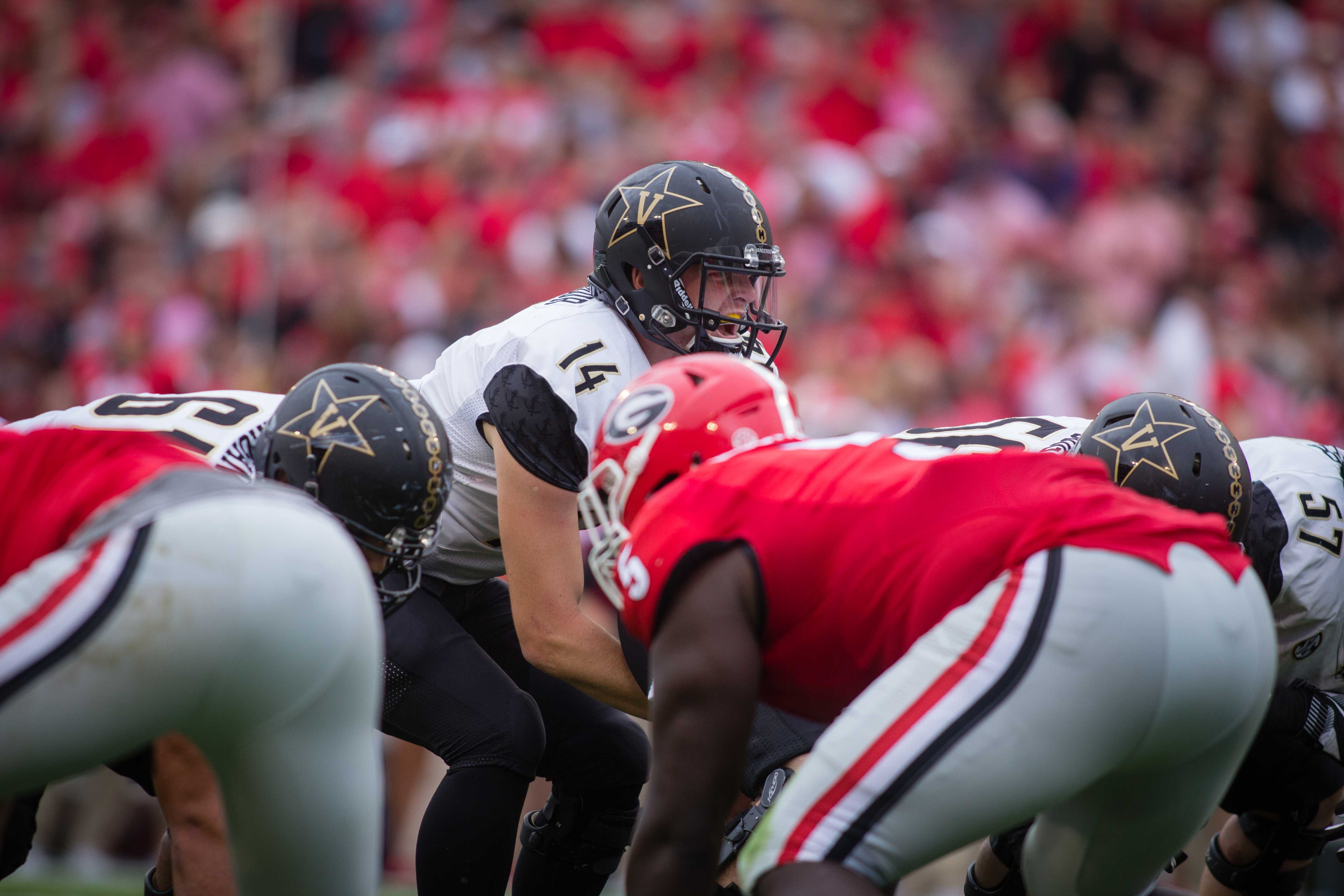 October 15th, 2016 – Kyle Shurmer on the line of scrimmage during the Commodores' 17-16 win against the University of Georgia in Sanford Stadium Saturday afternoon. Photo by Blake Dover.