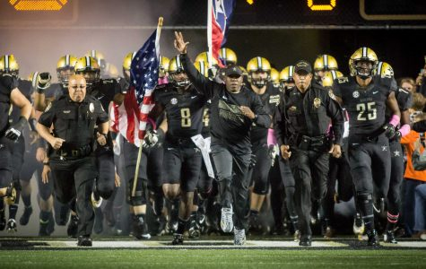 October 22nd, 2016 – Coach Mason leads the Commodores onto the field before their 35-17 win against TSU on Saturday Night at Vanderbilt Stadium. Photo by Blake Dover