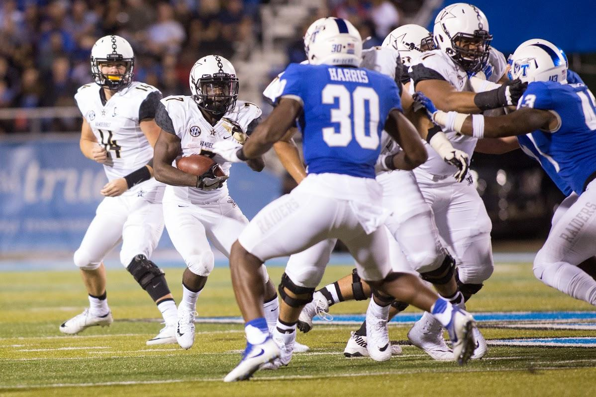 Ralph Webb takes the handoff on Saturday night's victory over Middle Tennessee
