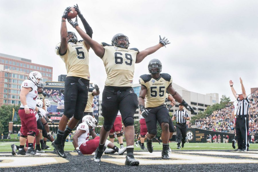 Adam Butler (69)  scores on a fumble recovery during Vanderbilt's game against UMass September 13, 2014 at Vanderbilt Stadium Nashville, TN. Vanderbilt won its first game of the season 34-31. Photo by Ziyi Liu.