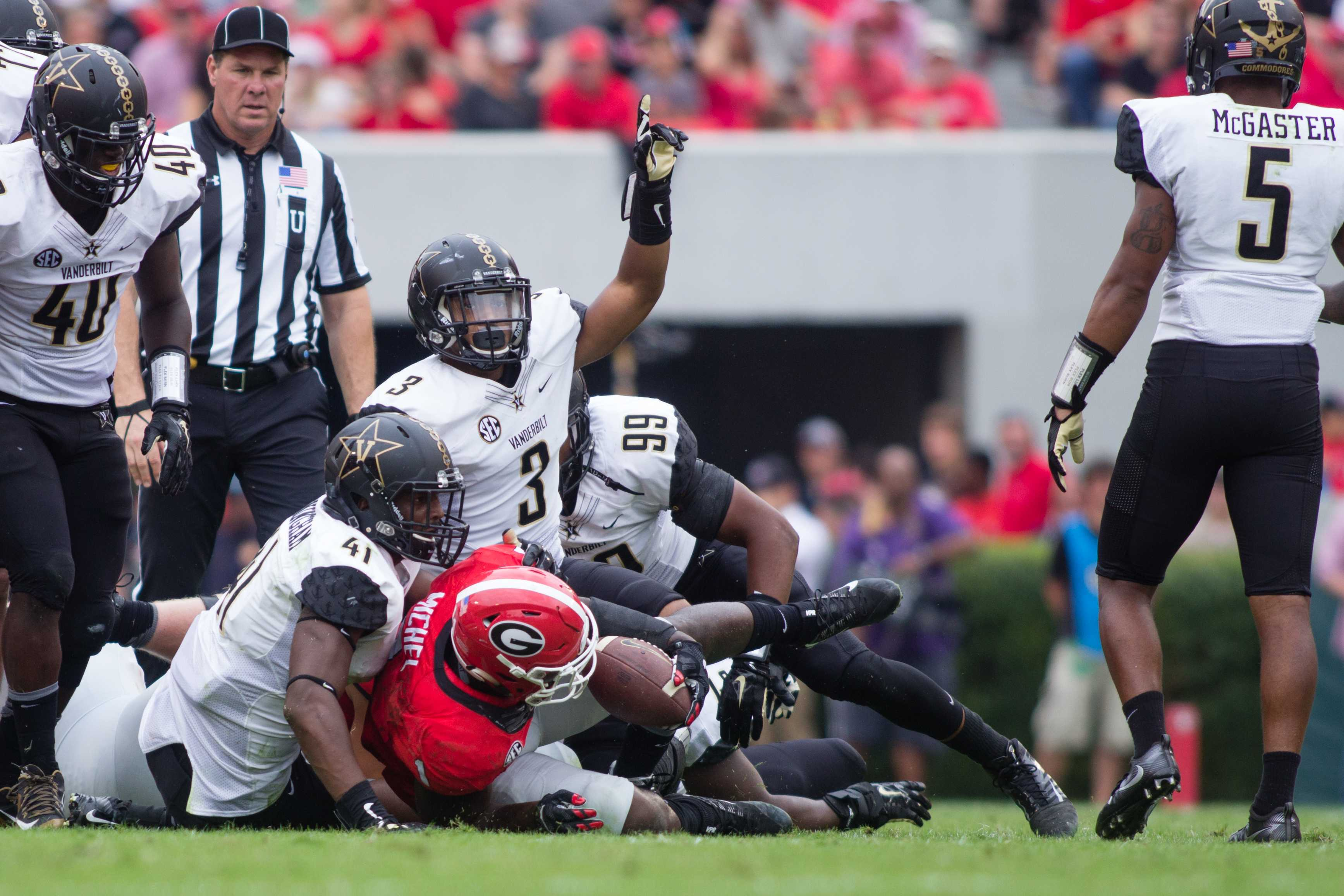 October 15th, 2016 – The Commodores defense makes a stop during their 17-16 win against the University of Georgia in Sanford Stadium Saturday afternoon. Photo by Blake Dover.