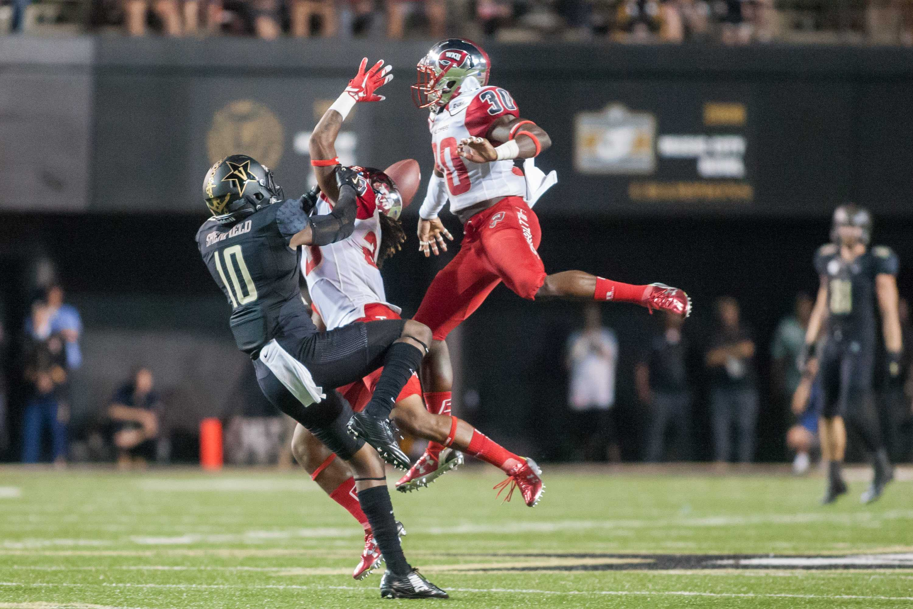 Trent Sherfield (10) is interfered with during Vanderbilt's 14-12 loss against the Western Kentucky Hilltoppers September 3, 2015 at Vanderbilt Stadium Nashville, TN. Photo by Ziyi Liu.