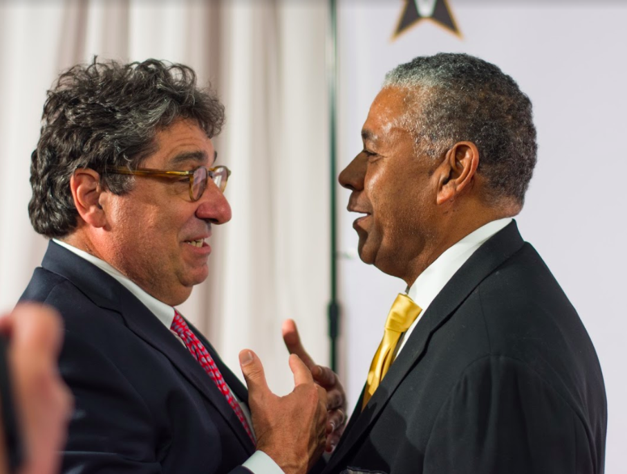 Chancellor Nicholas Zeppos (left) and Godfrey Dillard (right) meet at the red carpet before the premiere of 'Triumph'.