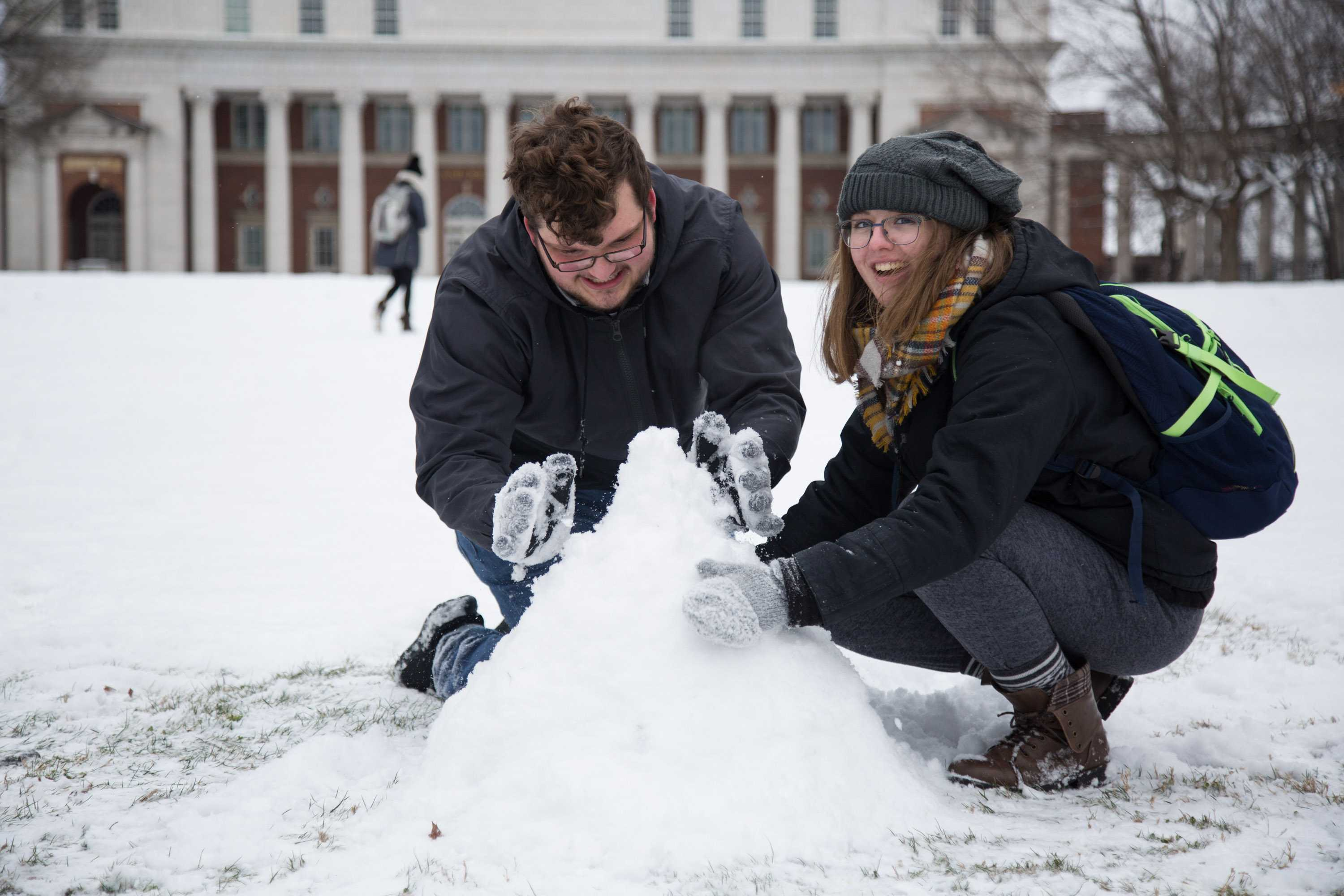 Snowy weather visits Vanderbilt on Tuesday, January 16, 2018. Two students took advantage of the precipitation to build a snowman on Wyatt Lawn. (Photo by Claire Barnett)