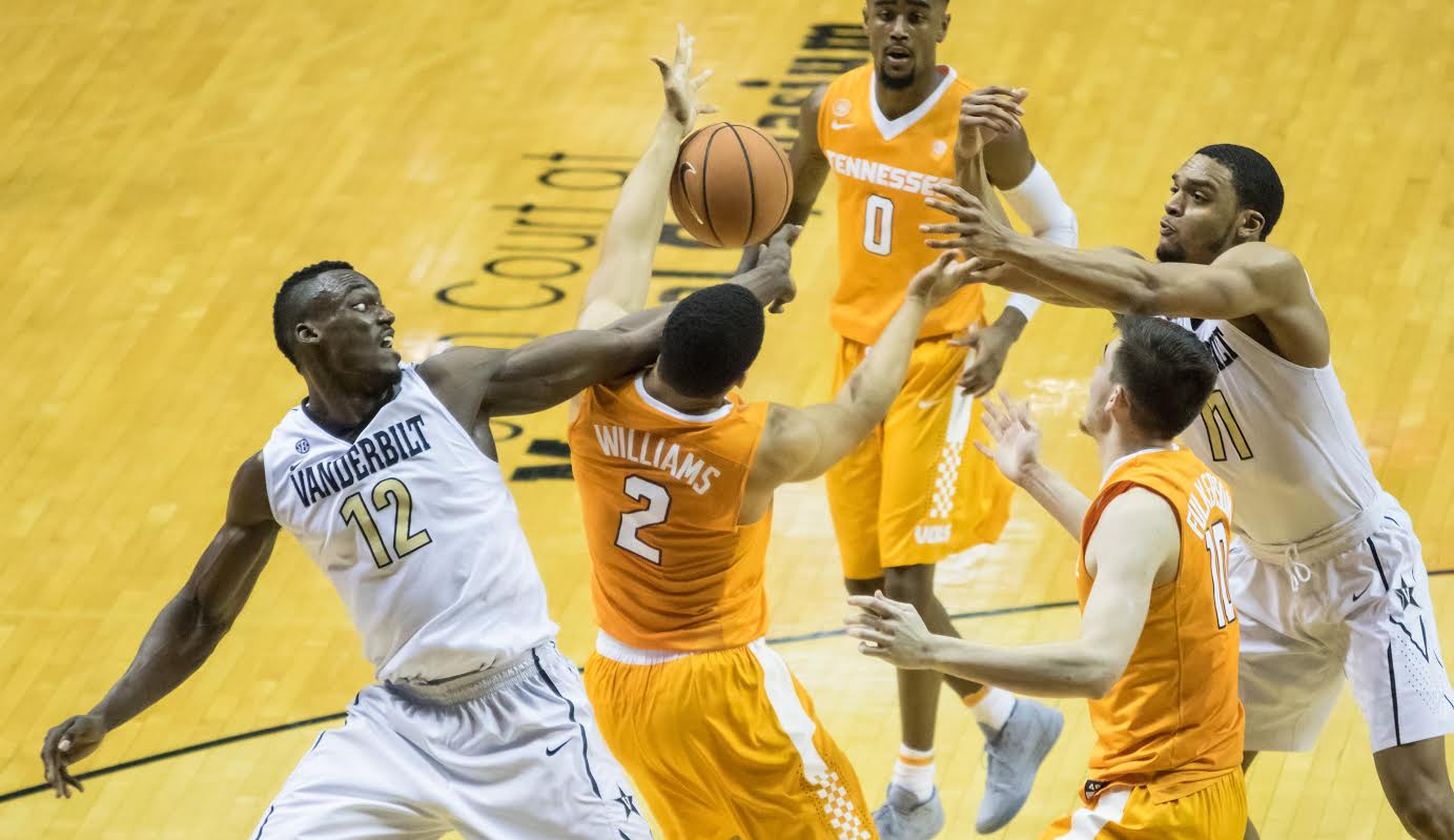 Djery Baptiste (12) and Grant Williams (2) go after a loose ball in Tennessee's 92-84 win over Vanderbilt.