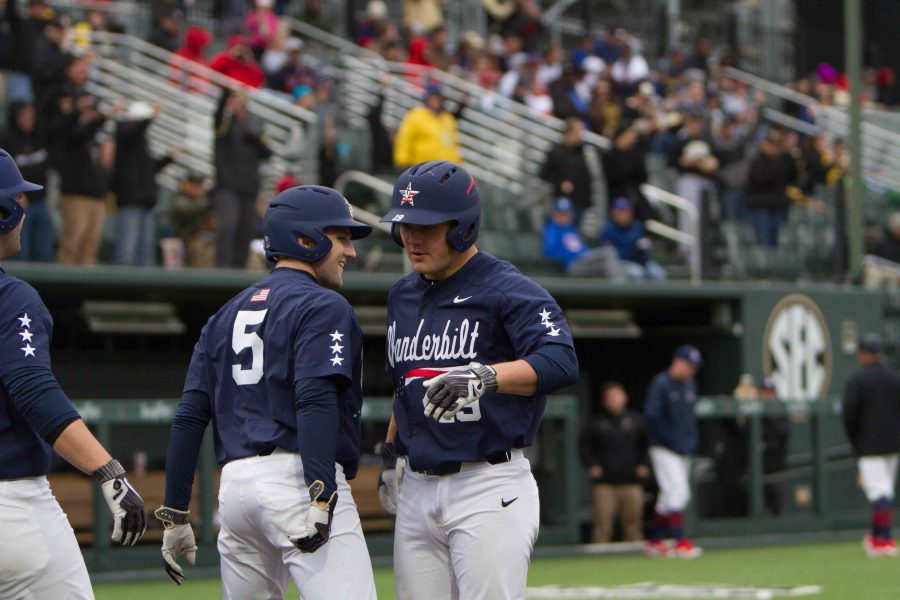 Vanderbilt+celebrates+its+second+home+run+of+the+game+against+Ole+Miss+An+Ole+Miss+first+baseman+stands+ready+during+the+game+on+Sunday+April+15%2C+2018.+%28Photo+by+Hunter+Long%29