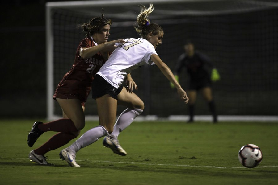 Haley Hopkins races an Alabama defender to the ball right outside Alabama's penalty box.