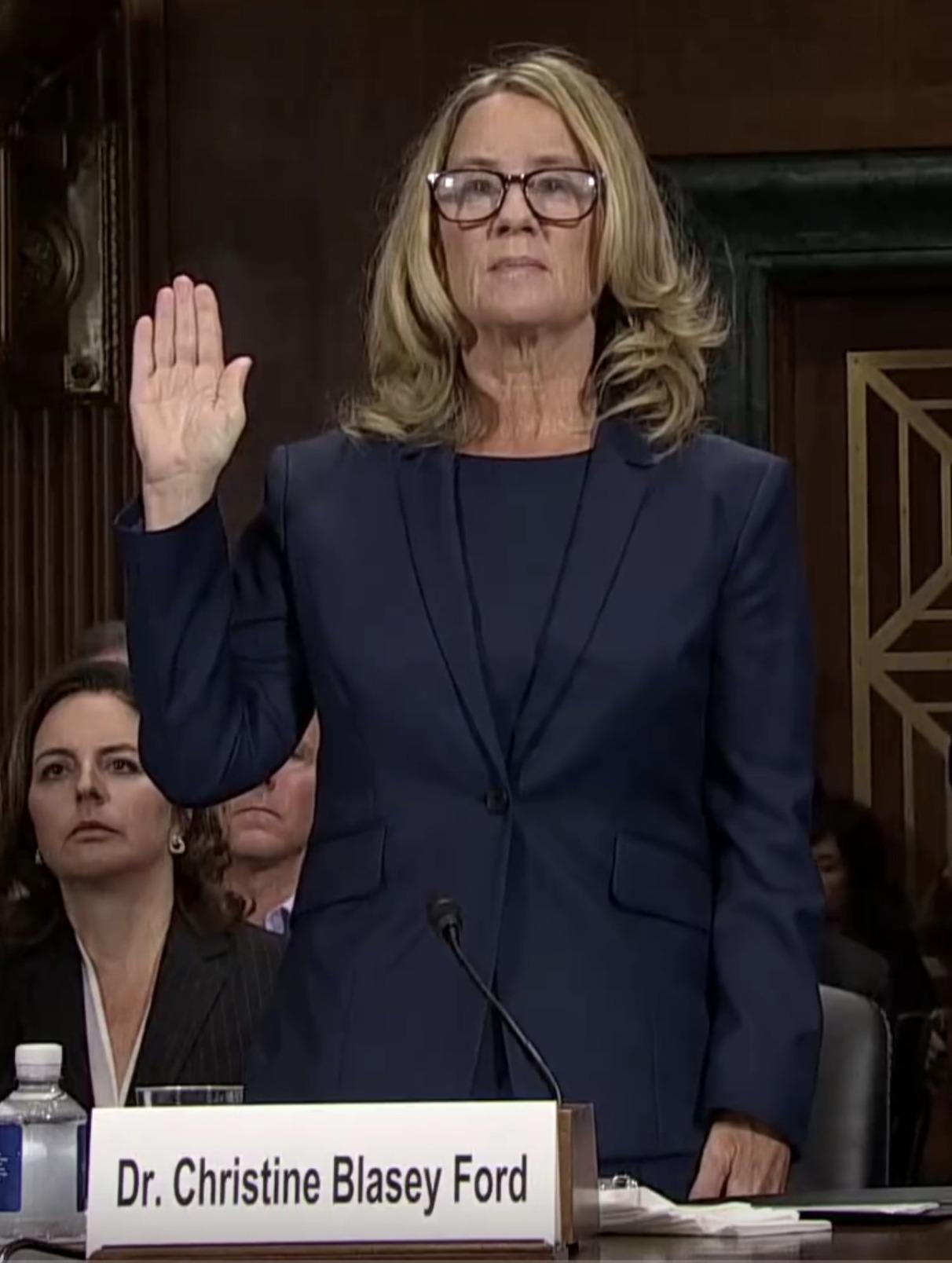 Christine Blasey Ford swearing in before the Senate Judiciary Committee. Photo credits: United States Senate Committee on the Judiciary.