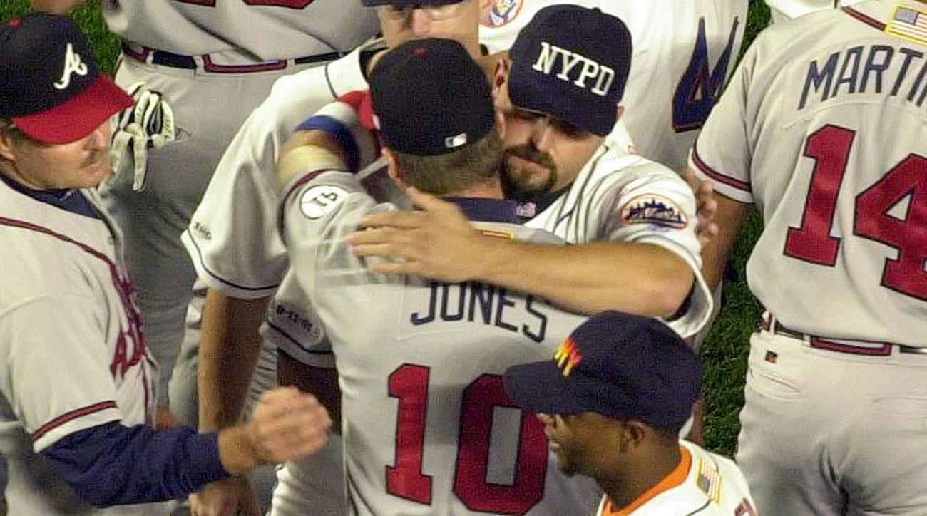 Mike Piazza and Chipper Jones Embrace after the game. Photo by Mark Lennihan, AP Photos/Sports Illustrated