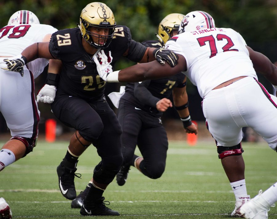Louis Vecchio (29) bursts through the line of scrimmage against South Carolina. (Photo by Hunter Long)