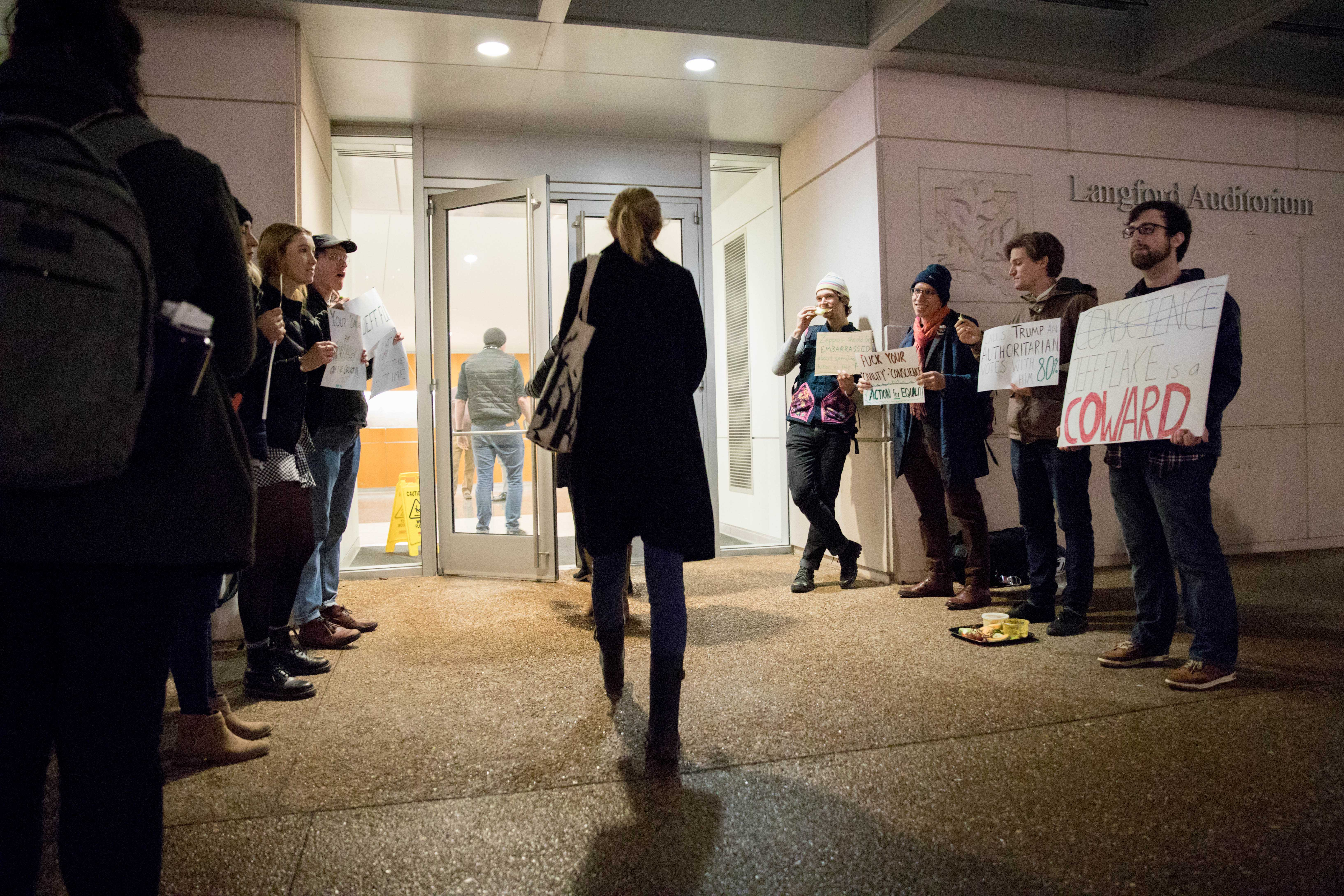 "Protestors call Sen. Flake ""coward,"" ""hypocrite"" outside of Chancellor's Lecture"