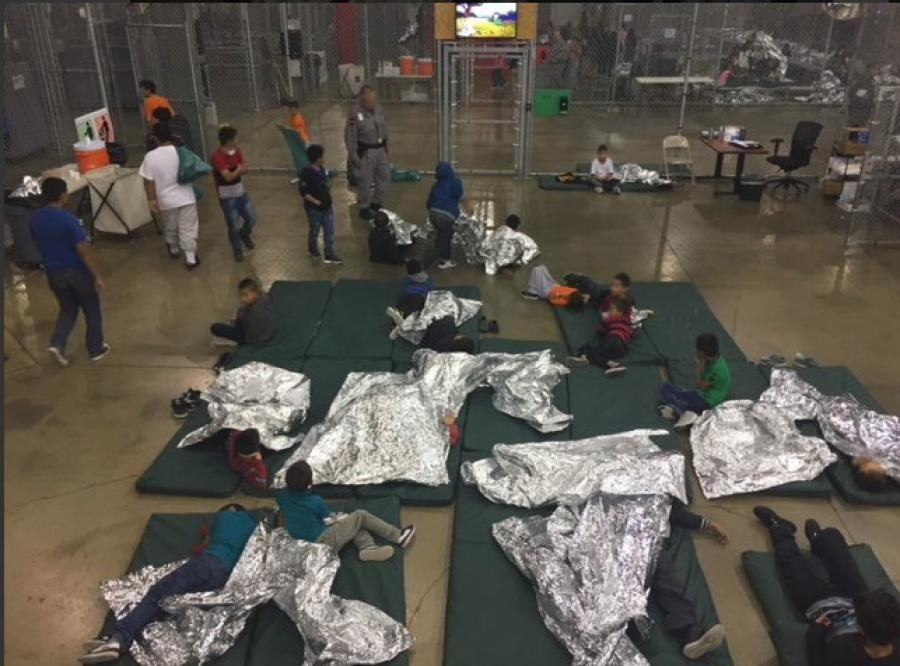 Migrant+children+sleeping+on+mats+in+a+Texas+detention+facility.+Photo+by+Custom+and+Border+Protection.