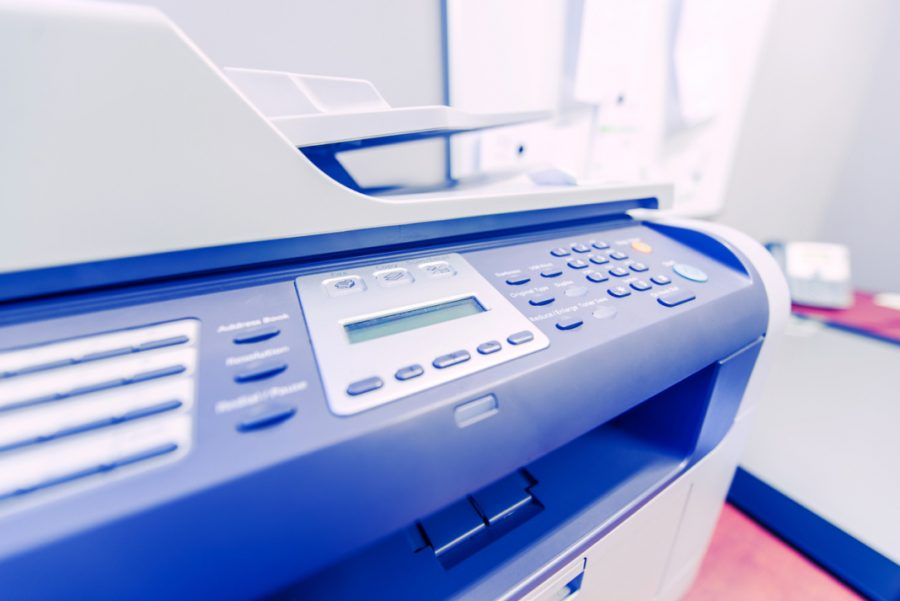 Office Network Printer. Network Printing in the Office Area. Printer Closeup Photo.