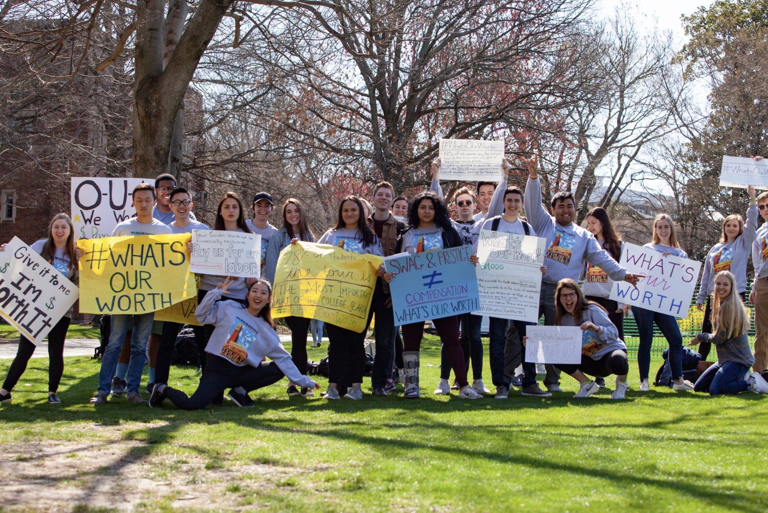 Tour guides petition for compensation on Alumni Lawn. (Photo by Madison Lindeman)