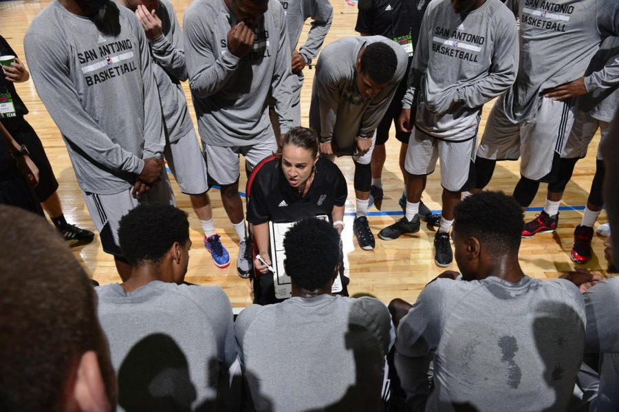 Coach Becky Hammon directs a play against the New York Knicks on July 11, 2015. Photograph by David Dow, 2015 NBAE