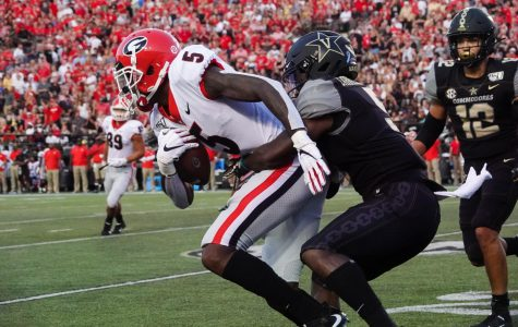 DC Williams holds back a Georgia player. (Photo by Mattigan Kelly)