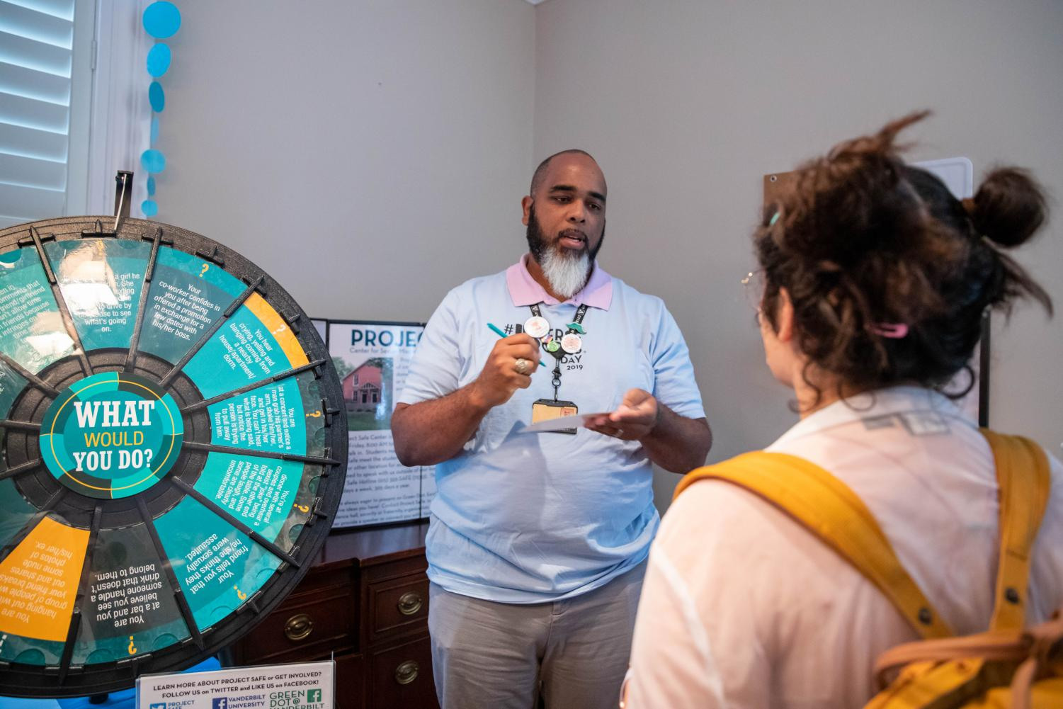 Students+spin+the+%22What+Would+You+Do%3F%22+wheel+and+learn+about+the+resources+at+Project+Safe+on+the+2019+Diverse+%27Dores+Day.+%28Photo+by+Emily+Gon%C3%A7alves%29