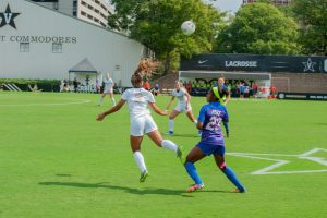 Madiya Harriott (#3) heads the ball over the Florida defender in Vandy's 0-1 loss to Florida at the Vanderbilt Soccer Complex on Sunday, September 29, 2019. (Hustler Multimedia/Truman McDaniel)