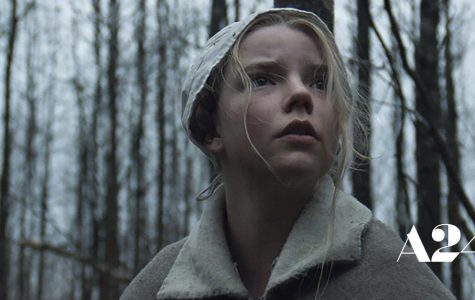 Thomasin looks into the woods in fear.  Image courtesy of a24films.com