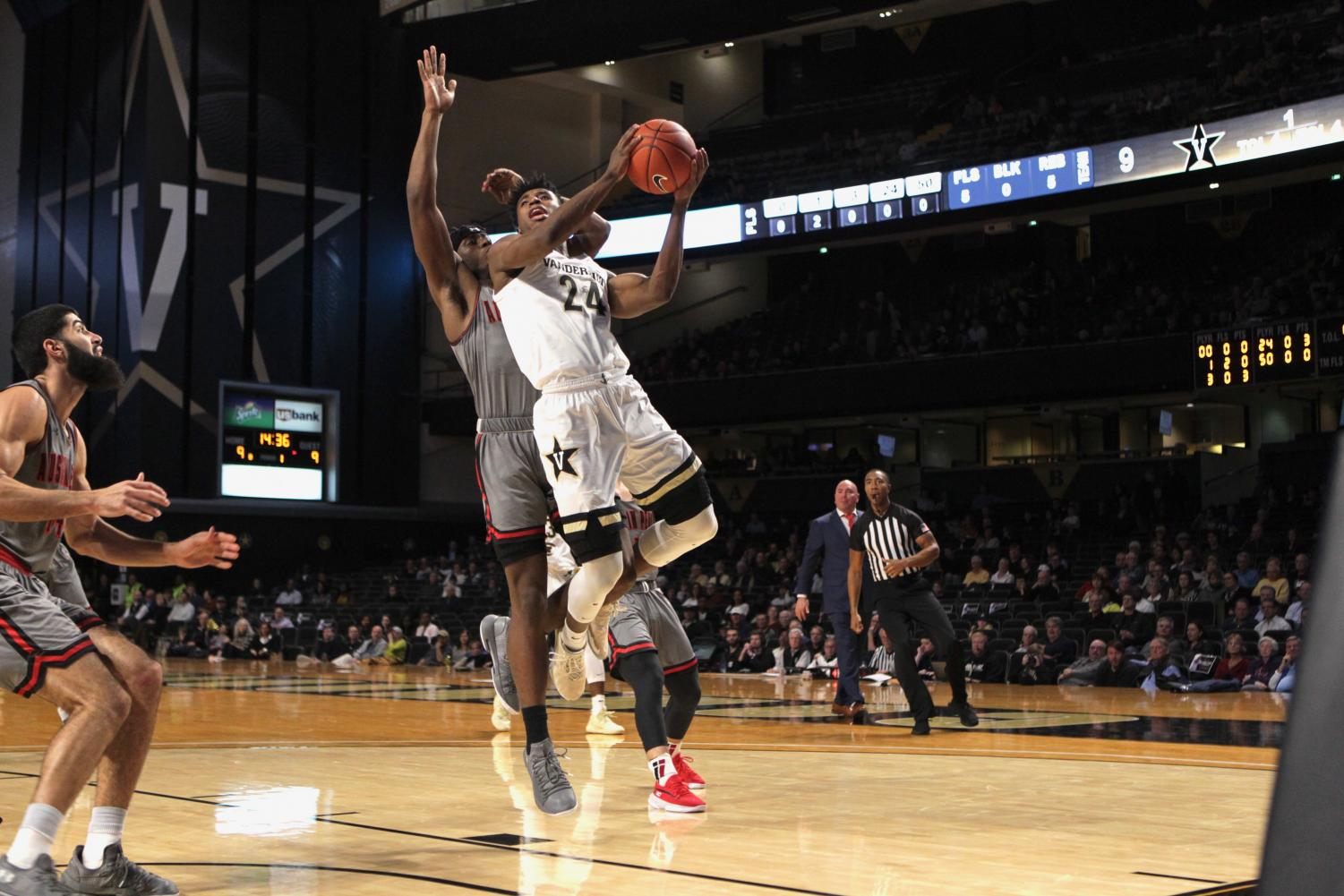 Aaron Nesmith finishes through traffic in Vanderbilt's 90-72 win over Austin Peay.