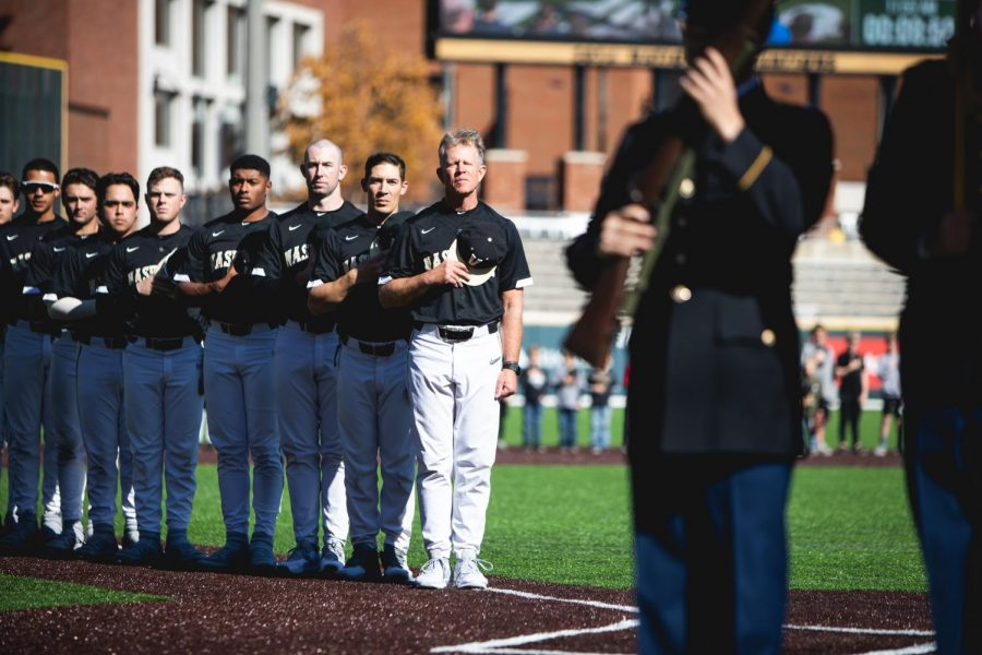 Head+Coach+Tim+Corbin+joined+by+his+coaching+staff+for+the+National+Anthem+prior+to+first+pitch.+