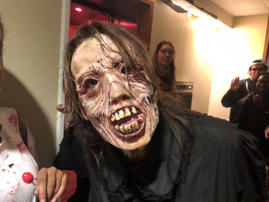 A student volunteer dresses up as one of the many horrifying actors working at the Crawford Haunted House (Photo by Shun Ahmed).