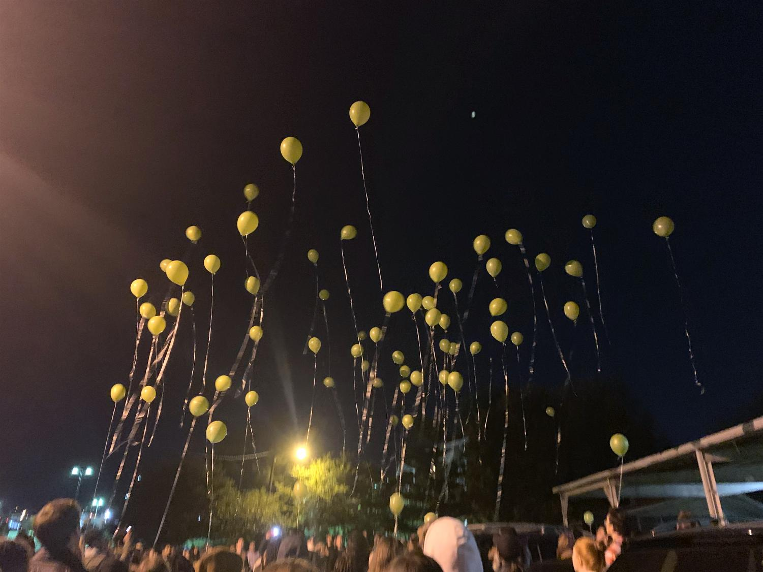 The vigil ended with the symbolic release of several dozen green balloons.