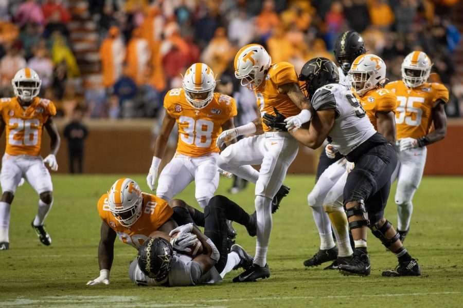 Kalija Lipscomb is brought down after a short gain in Vanderbilt's 28-10 loss to Tennessee on Saturday.