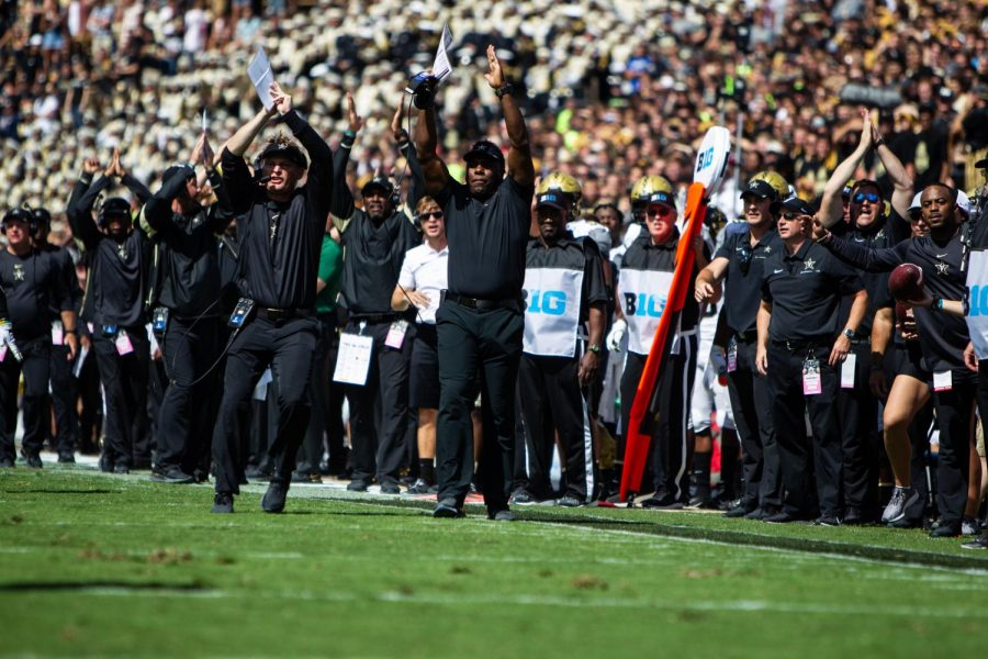 Head Coach Derek Mason and Defensive Coordinator Jason Tarver signal to their team as the Commodores take on Purdue.
