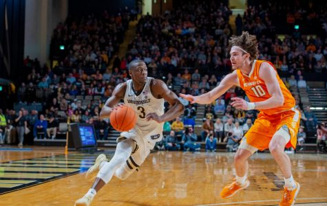 Maxwell Evans (left) drives past John Fulkerson (right) in Vanderbilt's blowout loss to Tennessee.
