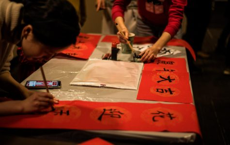 Students paint words of good luck at VUCA's Lunar New Year celebration Jan. 24.