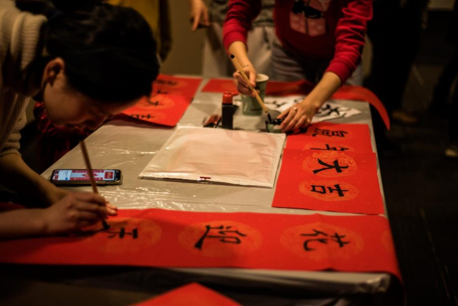 Students+paint+words+of+good+luck+at+VUCA%27s+Lunar+New+Year+celebration+Jan.+24.