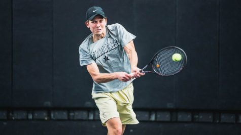Panu Virtanen returns a serve during his match-clinching singles victory.