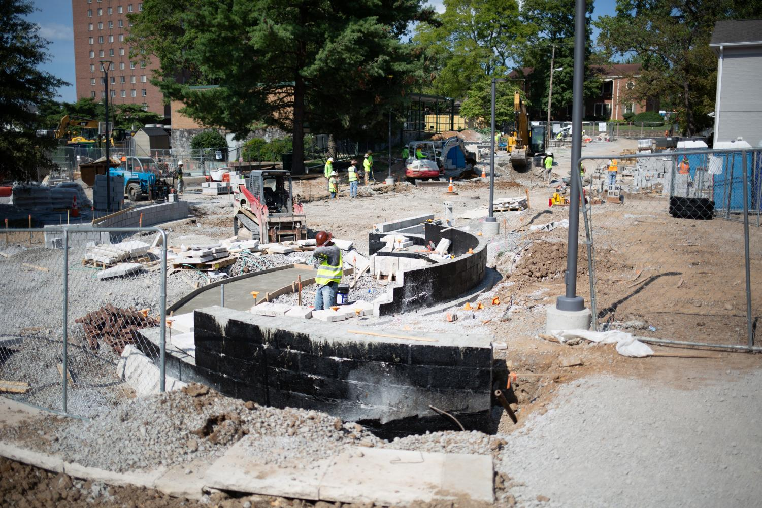 A construction crew works to transition Kensington Pl. to a green space on Aug. 18 as part of the redesign of the West End Neighborhood.
