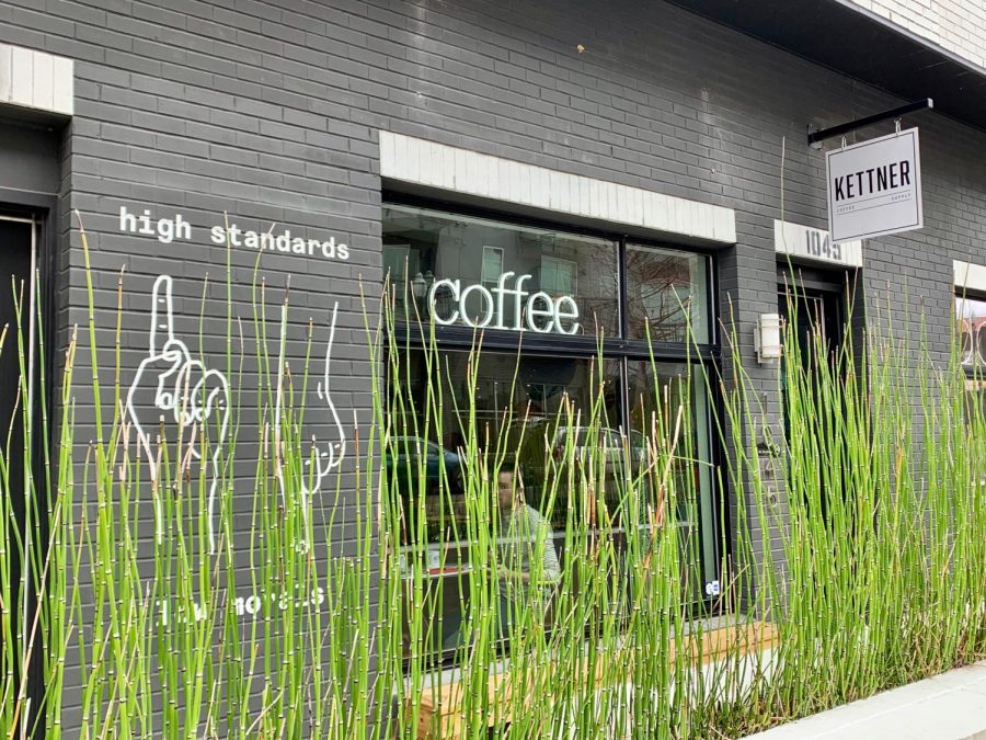 Kettner Coffee Supply is located in a gray apartment complex with a modern exterior.