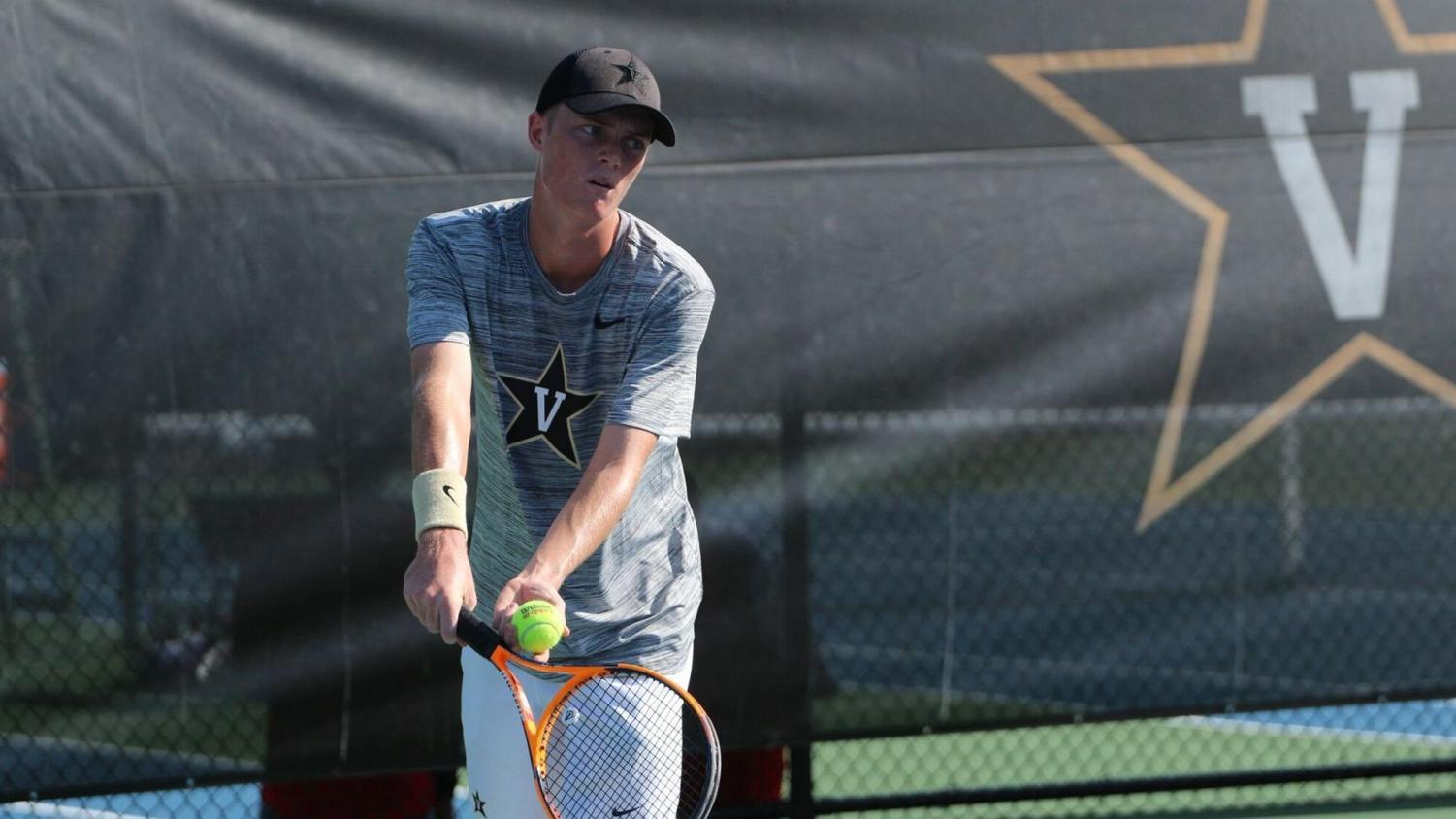 Marcus Ferreira gets ready to serve in his 6-2, 6-3 victory over Belmont's Arthur Toledo. Photo Credit VUCommodores.