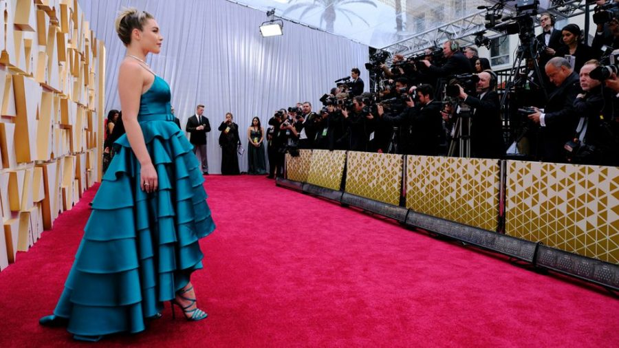 Florence Pugh shines in teal on the red carpet. Photo courtesy BBC