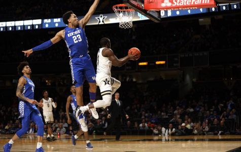 Maxwell Evans finishes over EJ Montgomery in the early moments of Vanderbilt's loss to Kentucky.