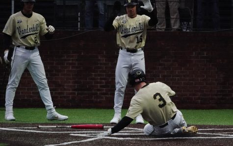 "Cooper Davis (3), who chose ""Portland"" by Drake as his entrance music, slides into home in Vanderbilt"