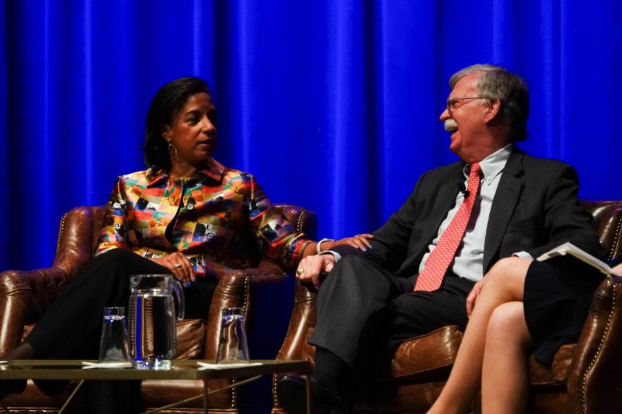 Susan Rice touches John Bolton's arm in Langford Auditorium
