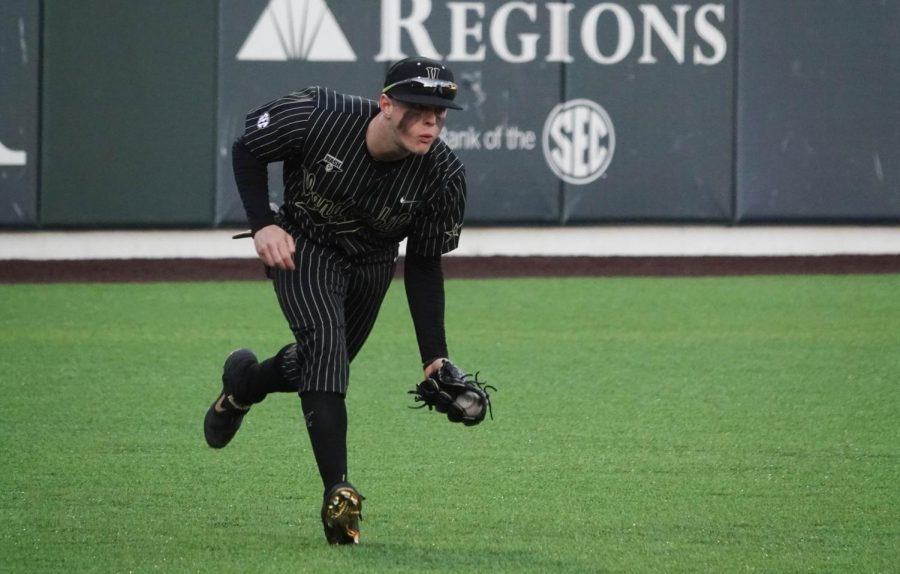 Cooper Davis fields a base hit in left field in Vanderbilt's 9-0 win over UIC on Friday night.