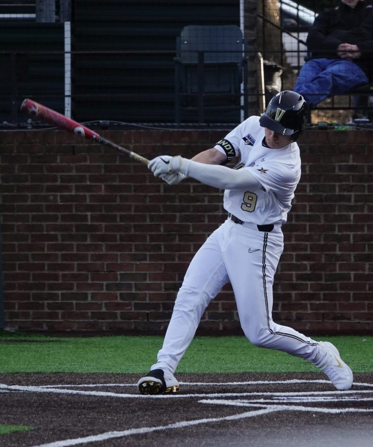 Carter Young (9) swings at a low pitch in Vanderbilt's 9-3 victory.